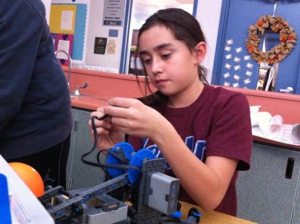 Chloe Langson, a fifth-grader at Twitchell Elementary, 2060 Desert Shadow Trail, participates in the school's new robotics program on Dec. 2. Cassandra Keenan/View