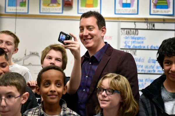 NASCAR Sprint Cup Series champion Kyle Busch smiles as student Ronan Magian takes a selfie with him during a visit to a STEM class at Lawrence Junior High School on Tuesday, Dec. 1, 2015, in Las V ...