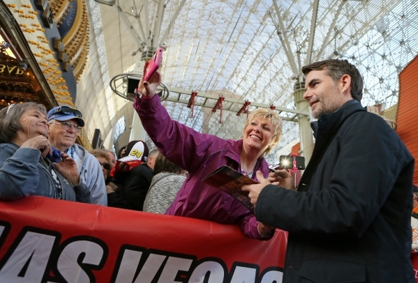 NASCAR driver Jeff Gordon, right, takes a photo with fan Rachel Klosterman, of Wyndmer N.D., during a NASCAR FanFest event at Fremont Street Experience Wednesday, Dec. 2, 2015, in Las Vegas. Drive ...