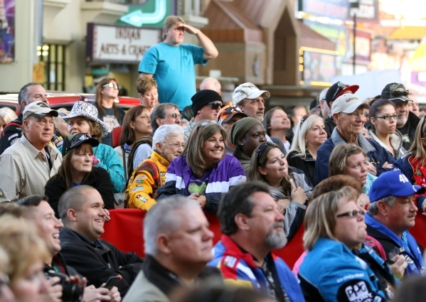 NASCAR fans attend a FanFest event at Fremont Street Experience Wednesday, Dec. 2, 2015, in Las Vegas. Drivers met fans while walking a red carpet and continued to Third Street Stage where they co ...
