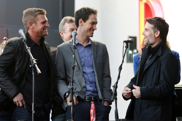 NASCAR drivers Clint Bowyer, from left, Joey Logano and Jeff Gordon share a laugh while they participate in a trivia game during a NASCAR FanFest event at Fremont Street Experience Wednesday, Dec. ...