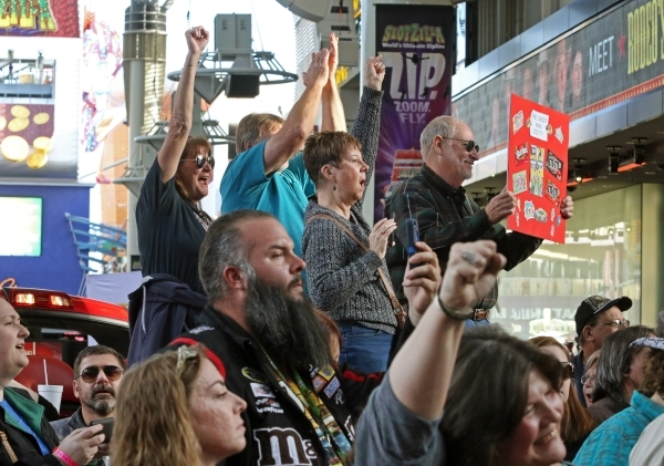 Fans cheer during a NASCAR FanFest event at Fremont Street Experience Wednesday, Dec. 2, 2015, in Las Vegas. Drivers met fans while walking a red carpet and continued to Third Street Stage where t ...