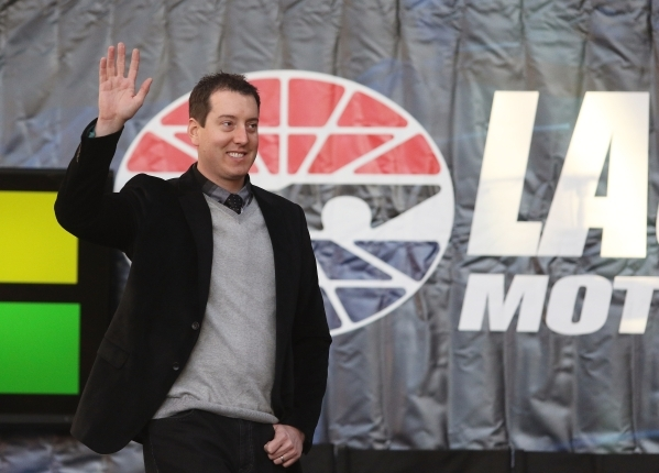 NASCAR driver and 2015 Spring Cup Series Champion Kyle Busch waves to fans during a NASCAR FanFest event at Fremont Street Experience Wednesday, Dec. 2, 2015, in Las Vegas. Drivers met fans while  ...