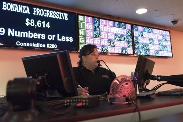 Bingo Agent, Vania Castro calls numbers in the bingo room at the Plaza hotel-casino in Las Vegas Tuesday, Dec. 1, 2015. Jason Ogulnik/Las Vegas Review-Journal