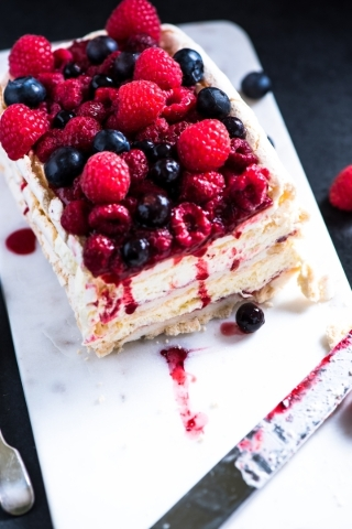 Homemade Pavlova with berry fruits on serving board