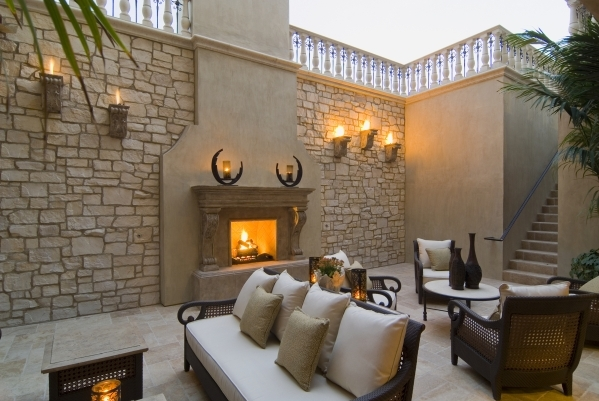 Cindy McCombs, co-owner of Realm of Design Inc. in Henderson, said demand is about 50/50 for old designs versus modern-looking fireplaces. Some mantles they've designed have been 25 feet tal ...