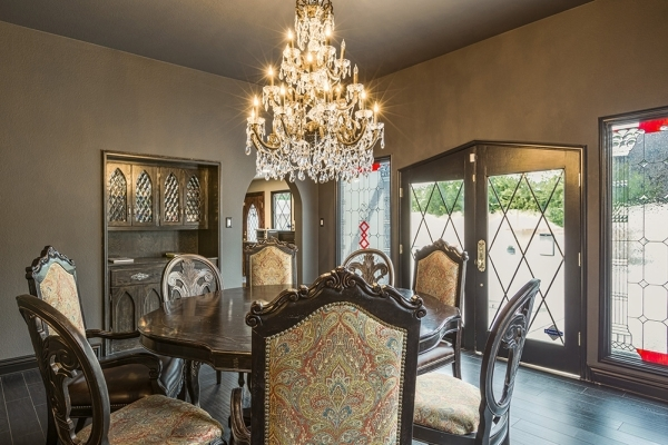 The Rancho Circle castle home has a Gothic crystal chandelier in the dining room. DAVID REISEMAN/REAL ESTATE MILLIONS