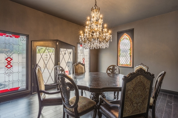 A Gothic crystal chandelier hangs in the dining area of the remodeled Rancho Circle castle. DAVID REISEMAN/REAL ESTATE MILLIONS