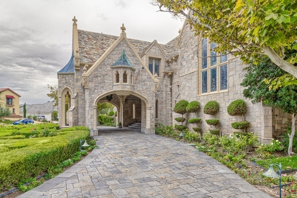 Jody Miller said she enjoyed her storybook childhood roaming the halls and nooks and crannies of her parent's 12,000-square-foot home, a replica of an 1800s Victorian castle, perched on pict ...