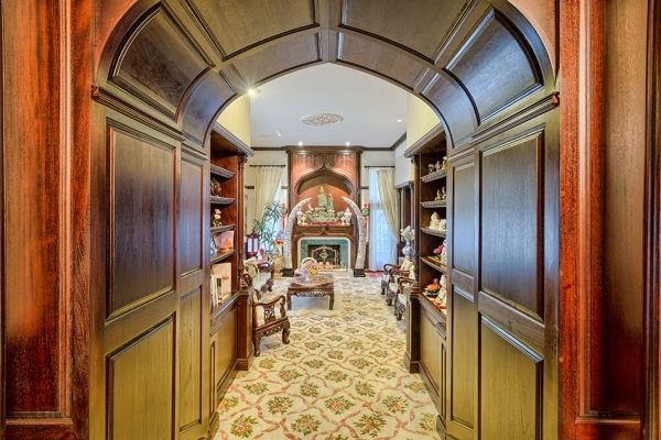 In addition to the massive wooden front door, there's about $1.5 million worth of carved mahogany wood fixtures throughout the authentic-looking English castle at Lake Sahara in Las Vegas. C ...