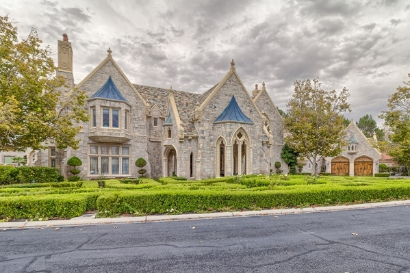 The Lake Sahara castle has six-bedrooms, six-baths, its own private boat dock and 144 custom windows of either stained- or beveled-glass. COURTESY