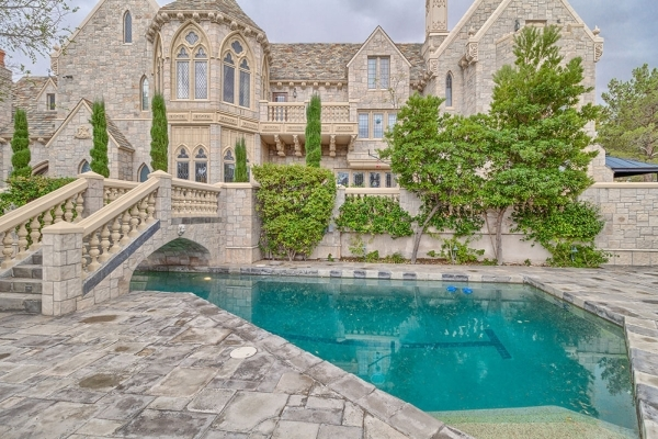 The 12,000-square-foot home, a replica of an 1800s Victorian castle, perched on picturesque Lake Sahara in The Lakes has a pool under its bridge. COURTESY