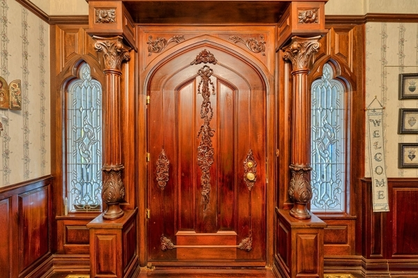 This home was named Rose Manor for ornate roses carved into the 12-inch front door. COURTESY