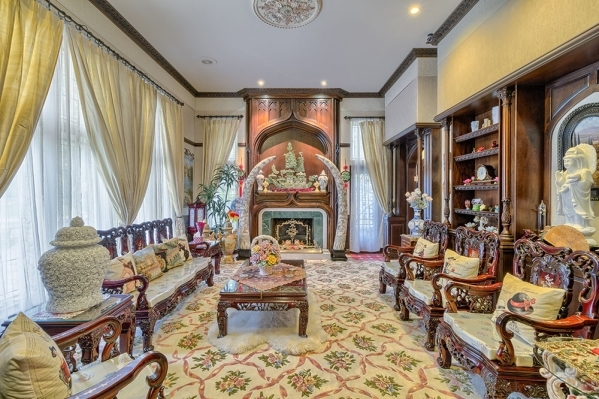 The living room in the castle at Lake Sahara in The Lakes features furniture that was designed with a medieval flare. COURTESY