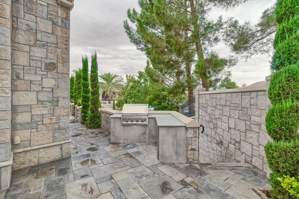 The Lake Sahara custom home may look like a castle but it has a modern outdoor kitchen. COURTESY