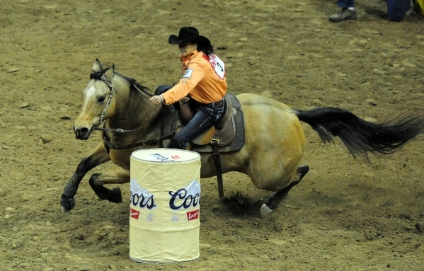 Barrel racer Lisa Lockhart of Oelrichs, S.D., races to a time of 18.76 during the 7th go-round of the National Finals Rodeo at the Thomas & Mack Center in Las Vegas Wednesday, Dec. 9, 2015. Jo ...