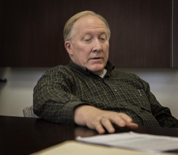 Boulder City Attorney Dave Olsen views a police file on former Boulder City Animal Control supervisor Mary Jo Frazier on Tuesday, Dec. 1, 2015. Frazier was under criminal investigation for illegal ...