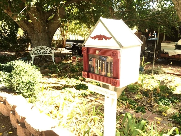 A Little Free Library shelter is seen Sept. 23 at 7263 W. Washburn Road. The little wood stations are popping up around town and encourage people to read. Jan Hogan/View