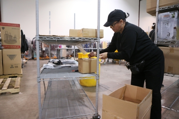 Cathy Williams, temporary worker at Beyond The Rack, checks a label on a box while on receiving duties at the Beyond The Rack warehouse in North Las Vegas Wednesday, Dec. 2, 2015. Erik Verduzco/La ...