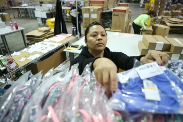 Maria Orozco, temporary worker at Beyond The Rack, organizes merchandise at the Beyond The Rack warehouse in North Las Vegas Wednesday, Dec. 2, 2015. Erik Verduzco/Las Vegas Review-Journal Follow  ...