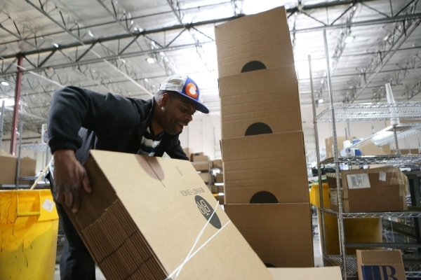 Eli Adkins, temporary worker at Beyond The Rack, moves boxes before assembling them at the Beyond The Rack warehouse in North Las Vegas Wednesday, Dec. 2, 2015. Erik Verduzco/Las Vegas Review-Jour ...