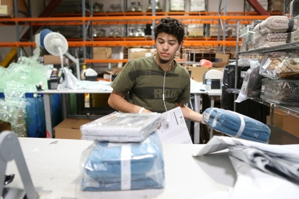 Jason Perez, temporary worker at Beyond The Rack, moves merchandise before packing at The Rack warehouse in North Las Vegas Wednesday, Dec. 2, 2015. Erik Verduzco/Las Vegas Review-Journal Follow @ ...