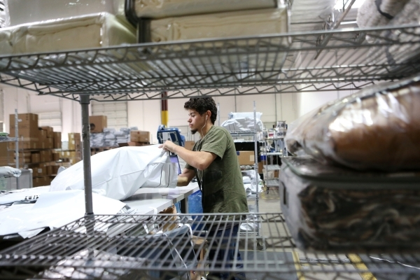 Jason Perez, temporary worker at Beyond The Rack, packs merchandise before shipping at The Rack warehouse in North Las Vegas Wednesday, Dec. 2, 2015. Erik Verduzco/Las Vegas Review-Journal Follow  ...