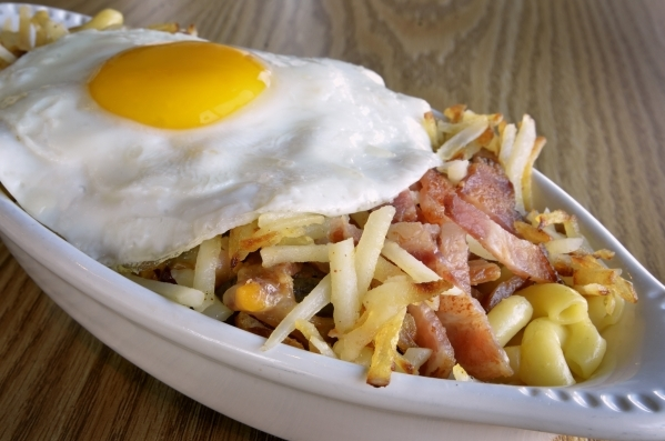 The Breakfast Mac þÄôN Cheese is shown at the Truffles N Bacon Cafe at 8872 S. Eastern Ave. in Las Vegas on Saturday, Dec. 5, 2015. The dish is made with bacon, hash browns, ham, macaroni ...