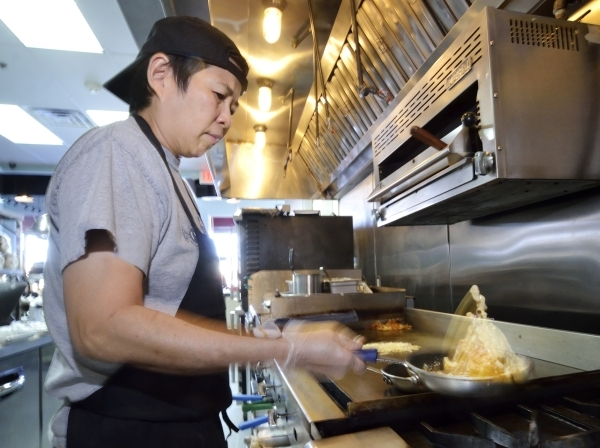 Chef Jackie Lim prepares a Breakfast Mac þÄôN Cheese at the Truffles N Bacon Cafe at 8872 S. Eastern Ave. in Las Vegas on Saturday, Dec. 5, 2015. The dish is made with bacon, hash browns, ...