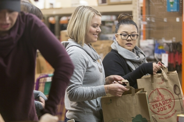 One hundred Junior League of Las Vegas volunteers helped stuff grocery bags with canned goods and other nonperishable items at HELP of Southern Nevada, 1640 E. Flamingo Road, Suite 100, Nov. 21, 2 ...