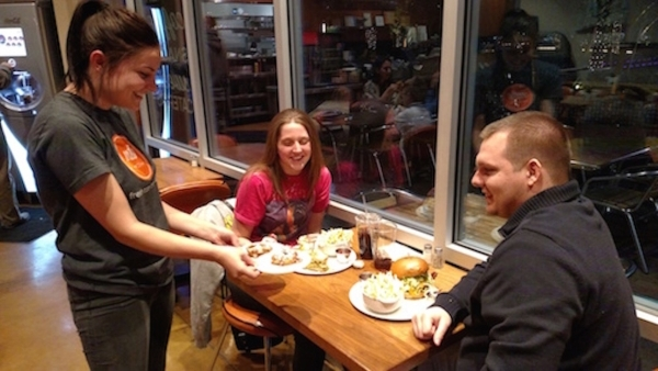 Waitress Shelby presents diners John and Sarah with free fried apple rings Nov. 23, 2015, at MTO Caf'€¡Â© Summerlin, 10970 Rosemary Park Drive, Suite 100. The Las Vegas eatery was celebr ...