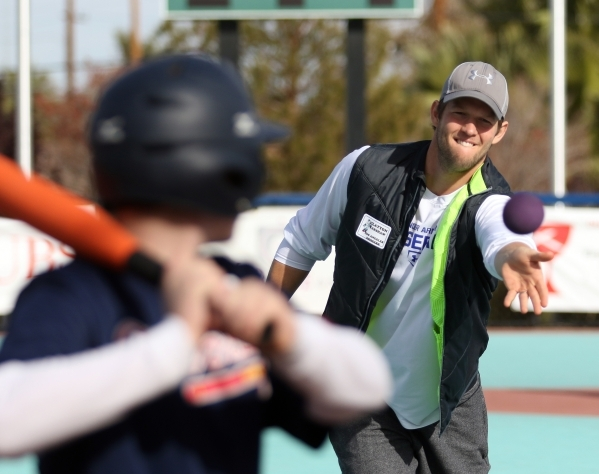 Los Angeles Dodgers' Clayton Kershaw, right, pitches during a Miracle League of Las Vegas baseball game Saturday, Dec. 5, 2015, in Las Vegas. Kershaw, a 2014 National League Most Valuable Pl ...