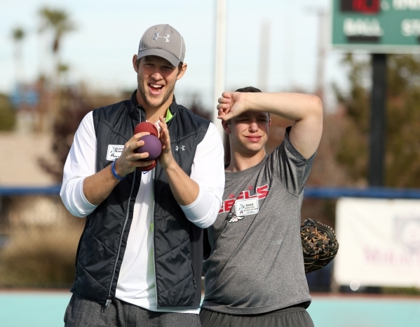 Los Angeles Dodgers' Clayton Kershaw, left, cheers alongside player Chad during a Miracle League of Las Vegas baseball game Saturday, Dec. 5, 2015, in Las Vegas. Kershaw, a 2014 National Lea ...