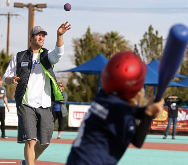 Los Angeles Dodgers' Clayton Kershaw, left, pitches to Abby during a Miracle League of Las Vegas baseball game Saturday, Dec. 5, 2015, in Las Vegas. Kershaw, a 2014 National League Most Valu ...