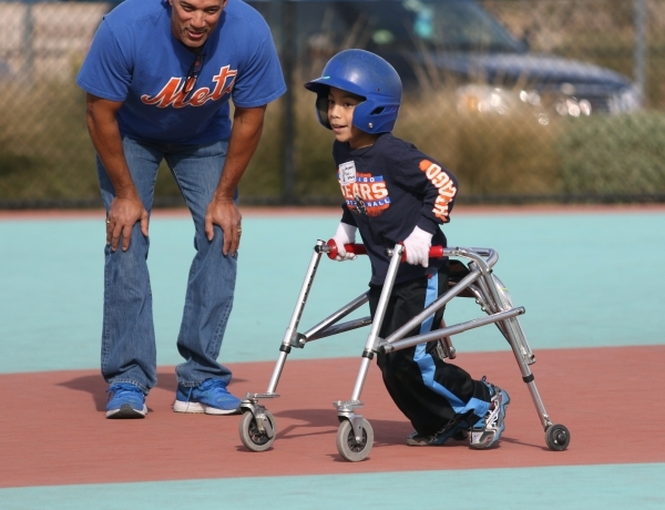 Jayson, right, runs to third base during a Miracle League of Las Vegas baseball game Saturday, Dec. 5, 2015, in Las Vegas. Clayton Kershaw, a 2014 National League Most Valuable Player, was special ...