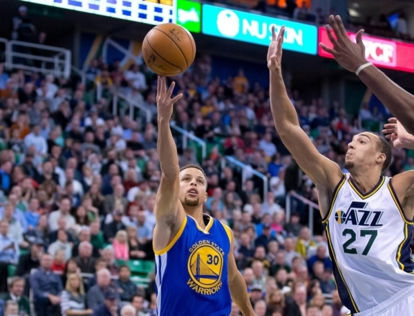 Nov 30, 2015; Salt Lake City, UT, USA; Golden State Warriors guard Stephen Curry (30) puts up a shot in front of Utah Jazz center Rudy Gobert (27) during the first quarter at Vivint Smart Home Are ...