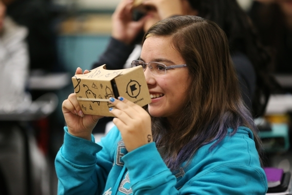 Lea Green, 13, explores using a Google Cardboard headset during a Google Expeditions program class at Leavitt Middle School in Las Vegas Friday, Dec. 4, 2015. The headset allows students to view a ...