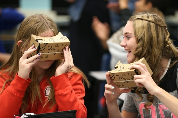 Aubreigh Heck, left, and Desirae Glass, both 13, explore using a Google Cardboard headset during a Google Expeditions program class at Leavitt Middle School in Las Vegas Friday, Dec. 4, 2015. The  ...