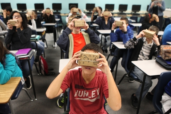 Nedim Cimic, 13, explores using a Google Cardboard headset during a Google Expeditions program class at Leavitt Middle School in Las Vegas Friday, Dec. 4, 2015. The headset allows students to view ...