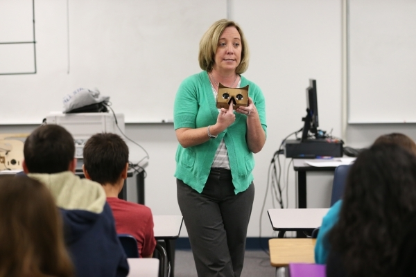 Heather Nail, digital learning coach at Leavitt Middle School, instructs students on using a Google Cardboard headset during a Google Expeditions program class at Leavitt Middle School in Las Vega ...