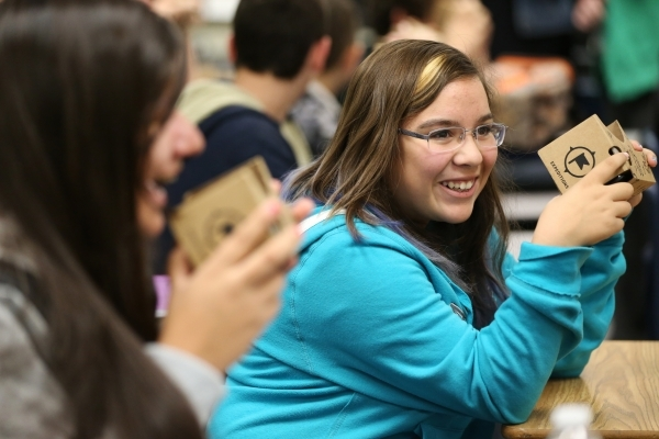 Lea Green, 13, shares a laugh with a classmate while using a Google Cardboard headset during a Google Expeditions program class at Leavitt Middle School in Las Vegas Friday, Dec. 4, 2015. The head ...