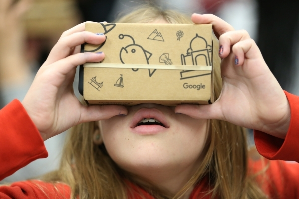 Aubreigh Heck, 13, explores using a Google Cardboard headset during a Google Expeditions program class at Leavitt Middle School in Las Vegas Friday, Dec. 4, 2015. The headset allows students to vi ...