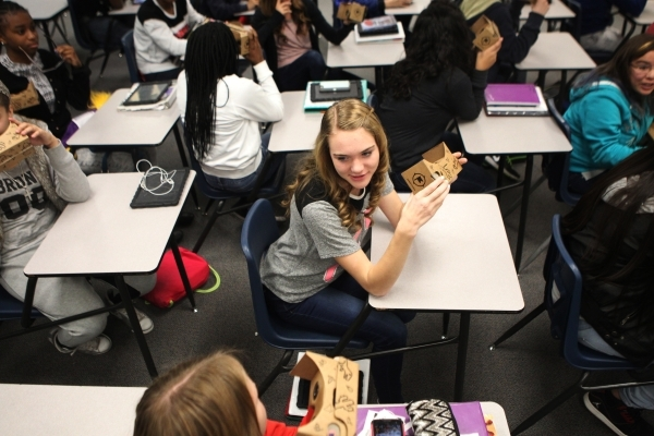 Desirae Glass, 13, holds the Google Cardboard headset during a Google Expeditions program class at Leavitt Middle School in Las Vegas Friday, Dec. 4, 2015. The headset allows students to view and  ...