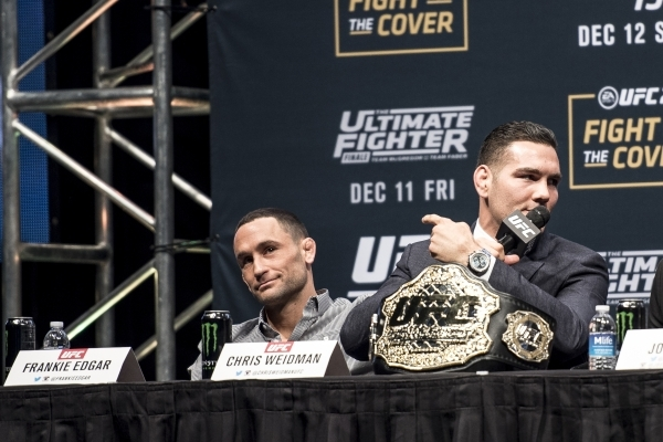 Chris Weidman points to Frankie Edgar during the UFC 194 press conference at the MGM Grand Garden Arena in Las Vegas on Wednesday, Dec. 9, 2015. Joshua Dahl/Las Vegas Review-Journal