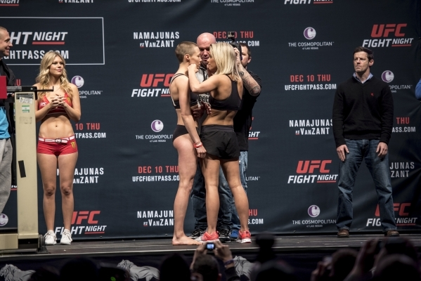 Rose Namajunas, left and Paige VanZant, right, square up as UFC President Dana White looks on during weigh ins for UFC Fight Night at the MGM Grand Garden Arena in Las Vegas on Wednesday, Dec. 9,  ...