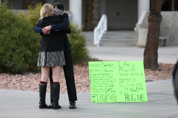UNLV student Naweed Yusufzai shares a hug with fellow student Kiley Ballew as he stood blindfolded on a walkway at UNLV to promote acceptance, love, and trust for one another as a Muslim on Friday ...
