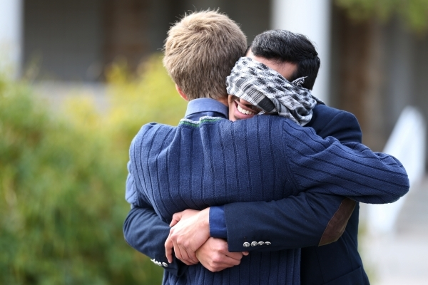 UNLV student Naweed Yusufzai, right, shares a hug with fellow student Glen Ellefson as he stood blindfolded on a walkway at UNLV to promote acceptance, love, and trust for one another as a Muslim  ...