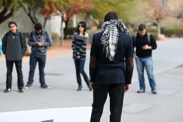 UNLV student Naweed Yusufzai stands blindfolded on a walkway at UNLV to promote acceptance, love, and trust for one another as a Muslim through hugs on Friday, Dec. 4, 2015. Erik Verduzco/Las Vega ...