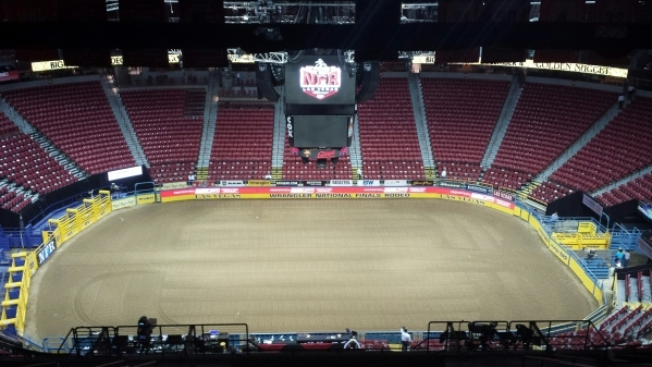 Though the start of Friday's second go-round of the Wrangler National Finals Rodeo was still an hour away, the view was spectacular from Nathan Lozano's seat in one of the new ADA-comp ...