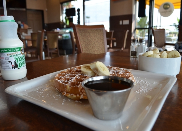 Breakfast options at Chickpeas Mediterranean Cafe include waffles served with fresh fruit. Ginger Meurer/Special to View